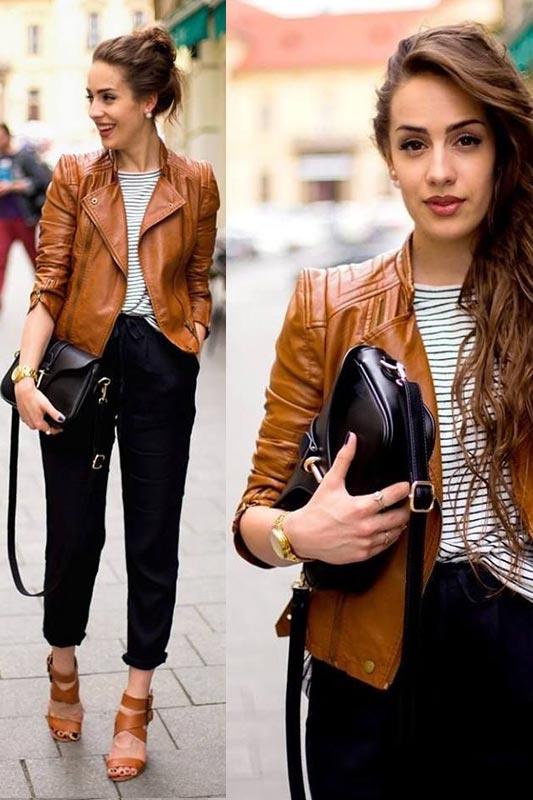 с темными брюками, полосатой футболкой, коричневыми босоножками